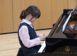 Fairfield pupil playing the Steinway Piano