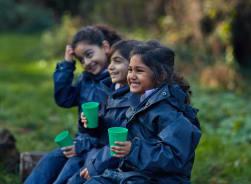 Fairfield children enjoying their drinks over at Forest School
