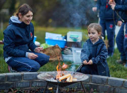 children learning to make food in Forest School