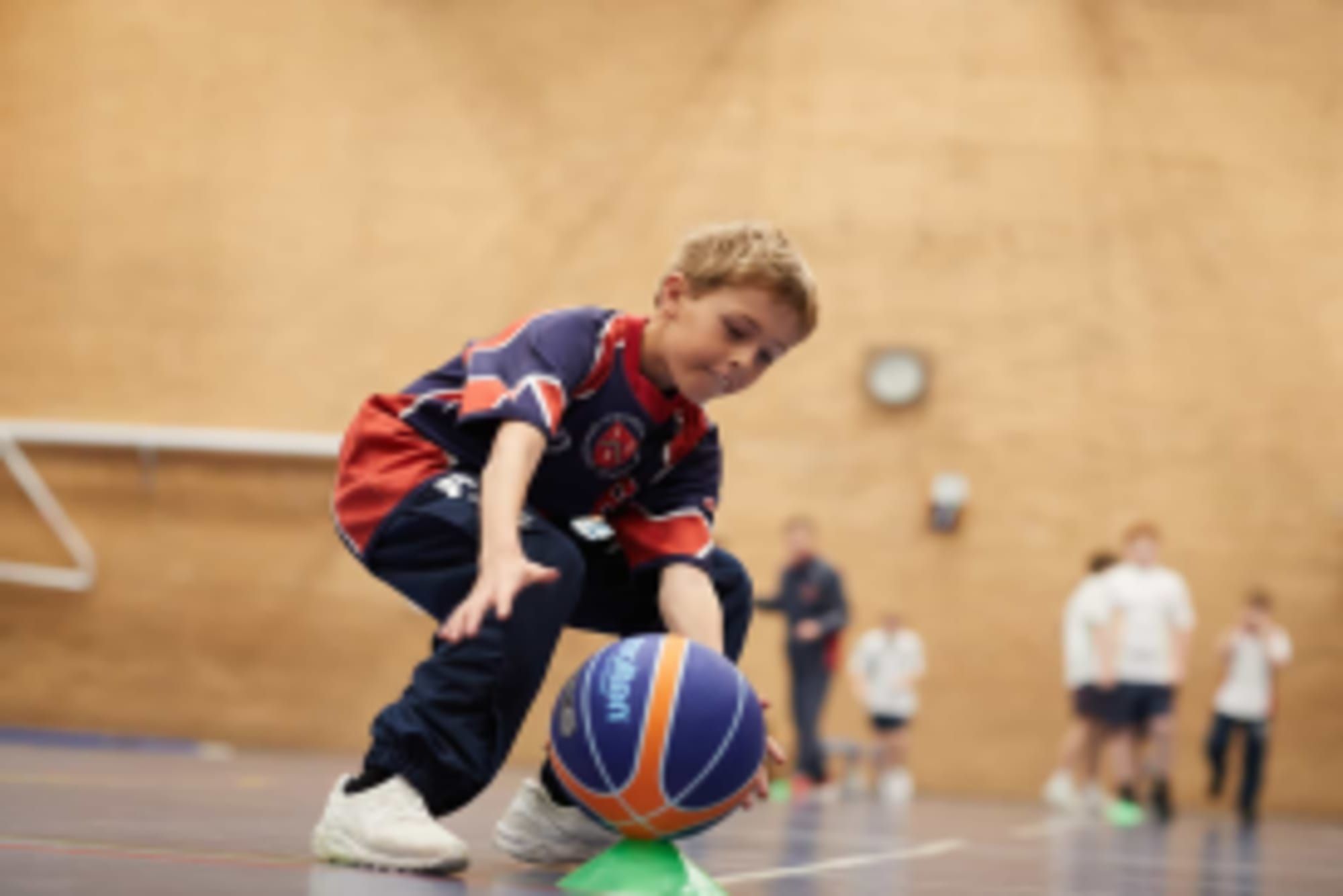 Year 6 pupil training in sports hall