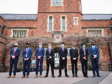 Grammar School students observe minute silence to mark a year since Covid lockdown featured image