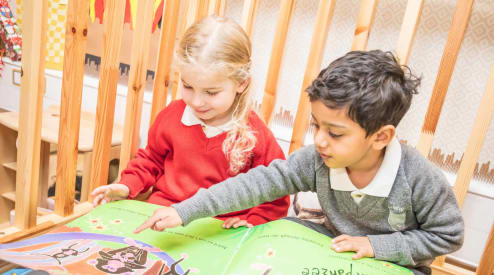 Pre-Prep children reading a book