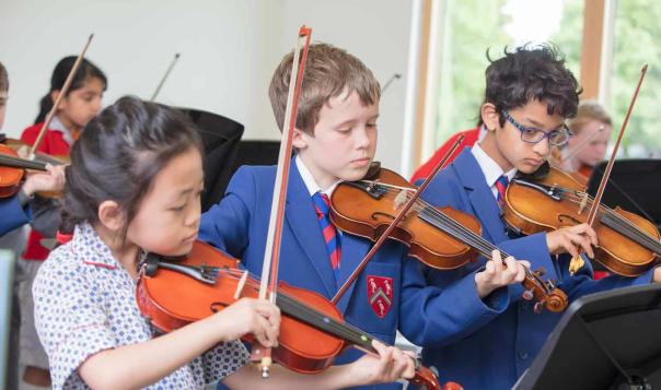 Fairfield pupils learning to play the violin