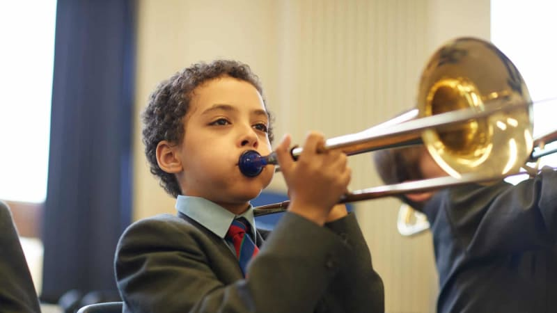 Year 6 pupil playing trombone