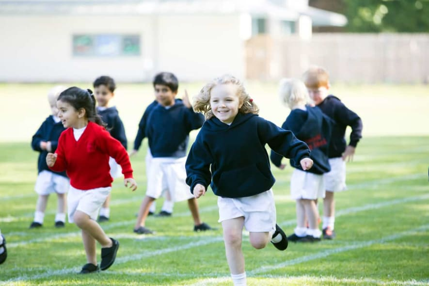 Pre-Prep children running on the sports field