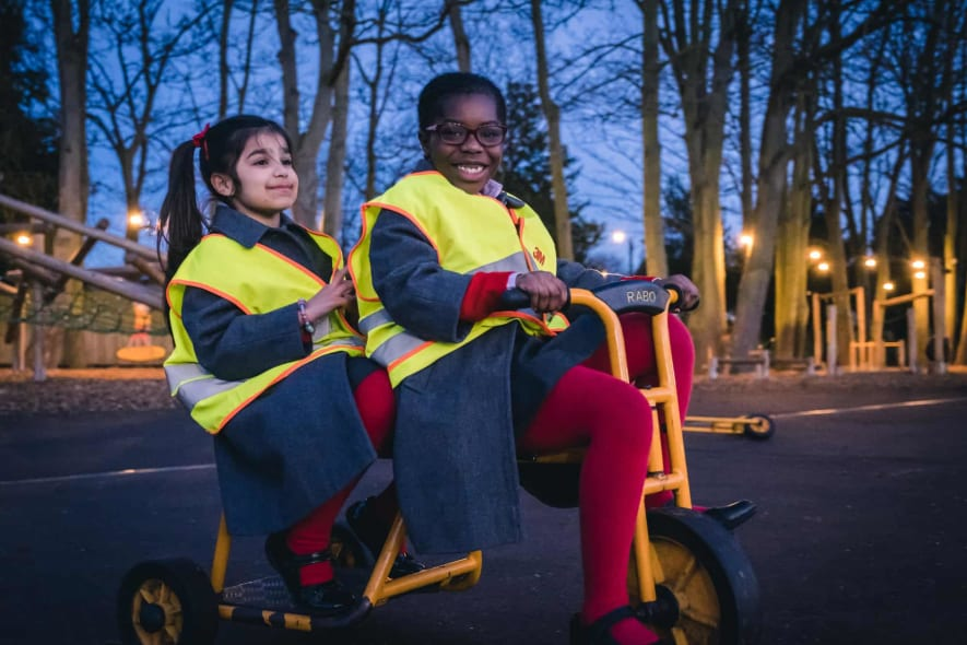 Fairfield pupils riding a bike.