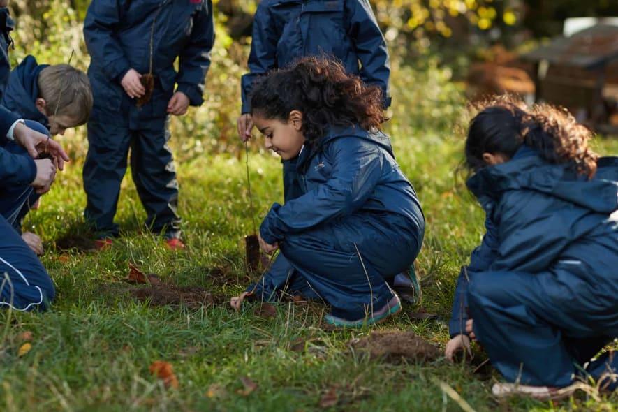Fairfield children digging in Forest School