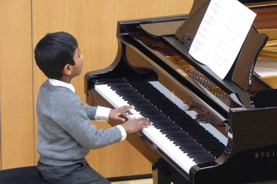 Fairfield pupil playing the piano