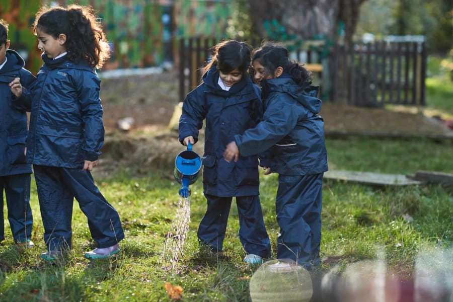 Fairfield children watering the fields over at Forest School