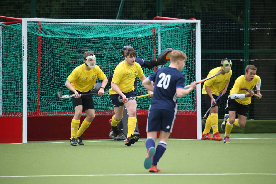 1st X1 versus a team of LGS Old Boys playing hockey in the opening ceremony of the new Astro