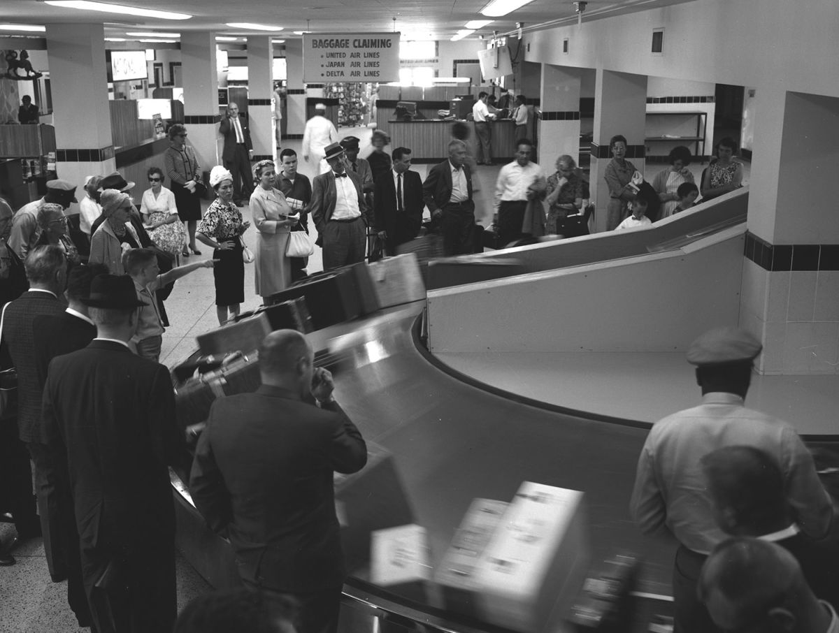 Passengers waiting for their luggage at San Francisco airport in 1962
