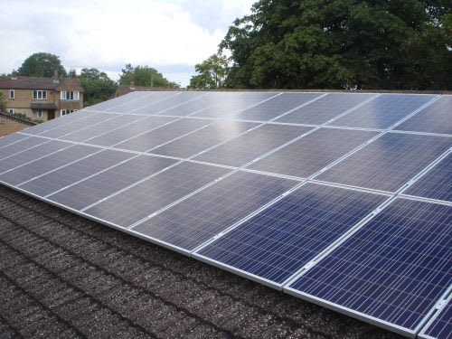 Solar panels on the rooftop of Wheatley Park School, owned and managed by Low Carbon Hub