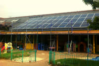 Solar panels on the rooftop of Long Furlong School, owned and managed by Low Carbon Hub