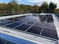 Solar panels on the rooftop of Longfields School, owned and managed by Low Carbon Hub