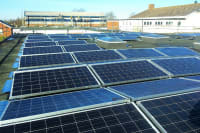 Solar panels on the rooftop of Langtree School, owned and managed by Low Carbon Hub