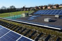 Solar panels on the rooftop of Fir Tree School, owned and managed by Low Carbon Hub