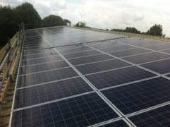 Solar panels on the rooftop of The Warriner School, owned and managed by Low Carbon Hub