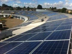 Solar panels on the rooftop of Orchard Fields School, owned and managed by Low Carbon Hub