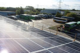 Solar panels on the rooftop of Thames Travel, owned and managed by Low Carbon Hub