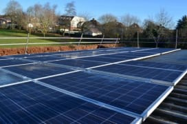 Solar panels on the rooftop of West Kidlington School, owned and managed by Low Carbon Hub