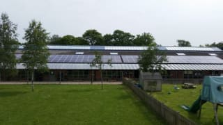 Solar panels on the rooftop of Chilton School, owned and managed by Low Carbon Hub