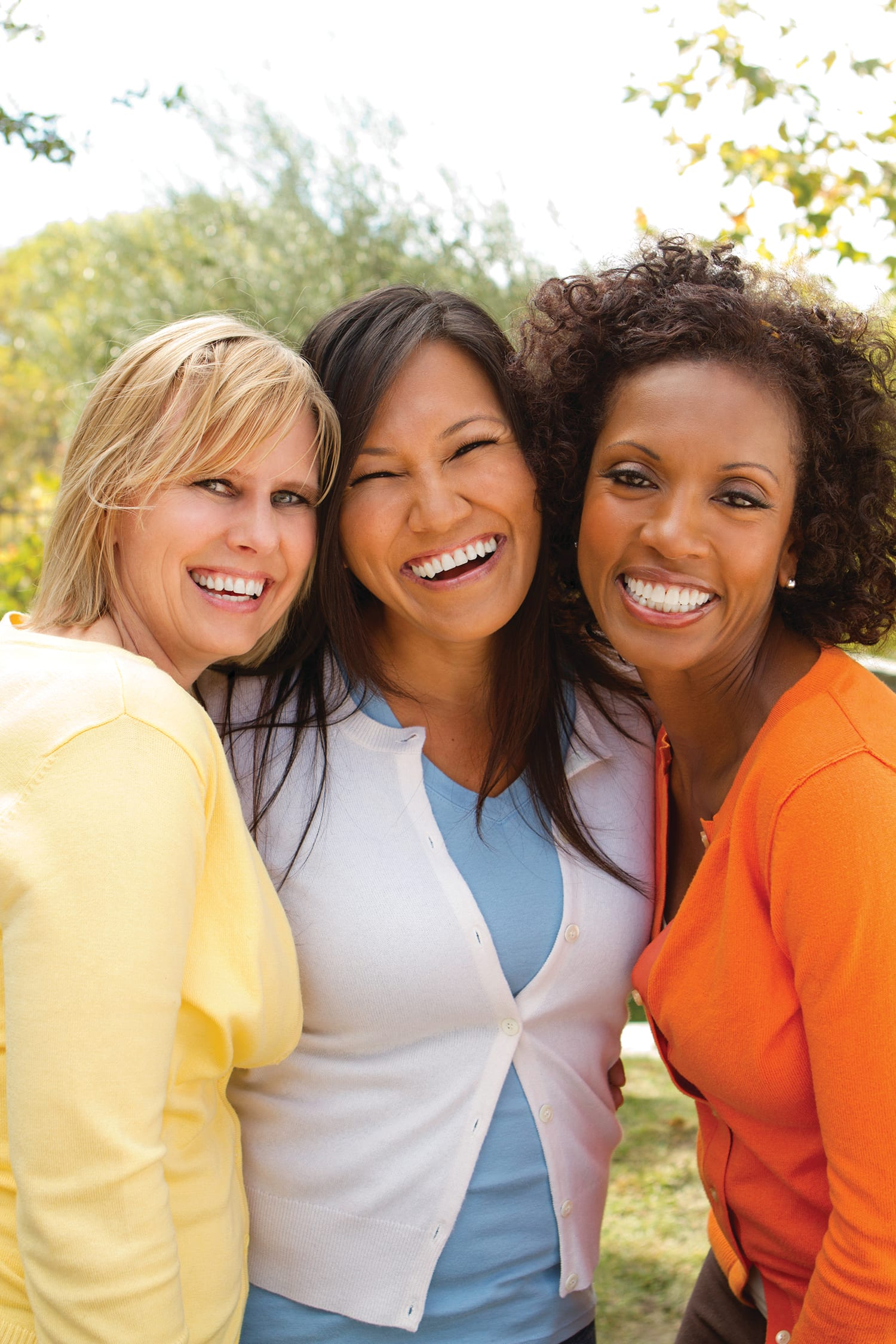 Three women of different ethnic backgrounds
