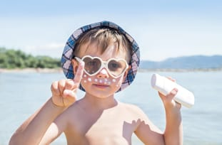 July is UV Safety Month - kid at beach