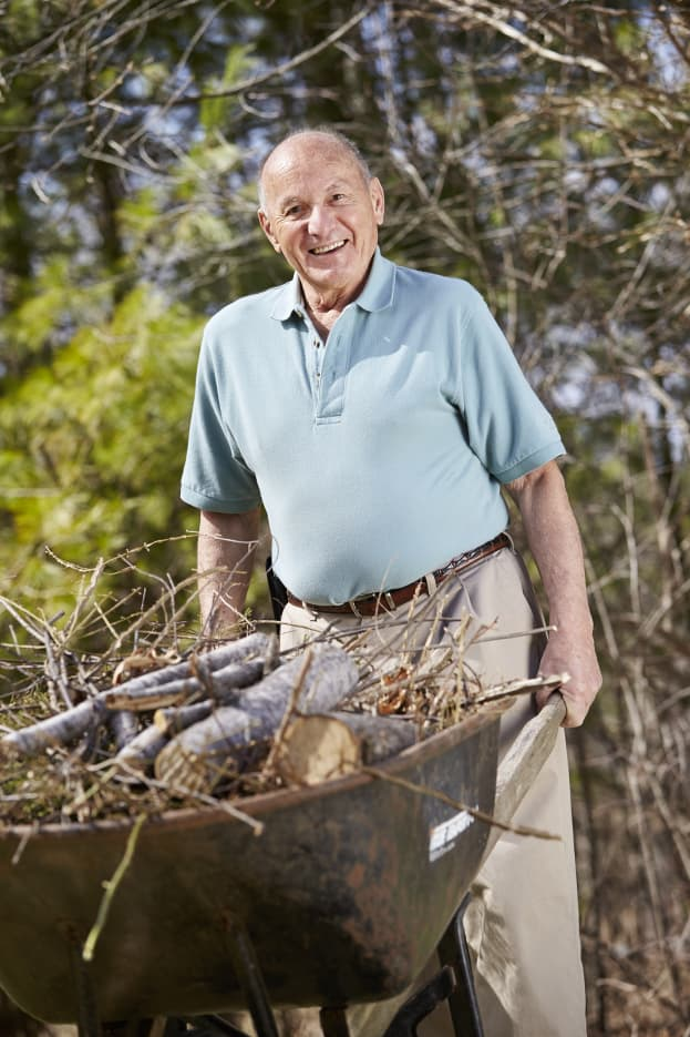 Orthopedic patient Charlie pushes wheelbarrow
