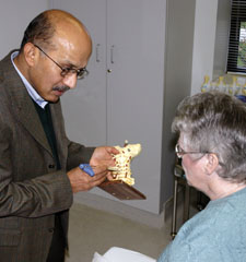 G.K. Dwarakanath, MD, with a patient in the Pain Management Center at Lowell General Hospital