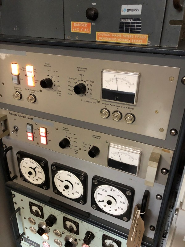 Practical rack mount panels in cabinet with dials and illuminated buttons