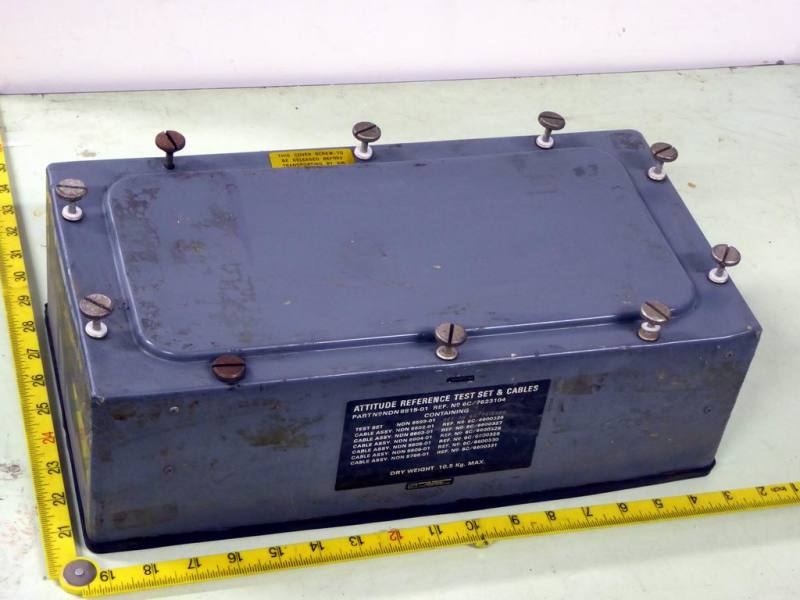 Battleship grey case lid with large prominent screw heads