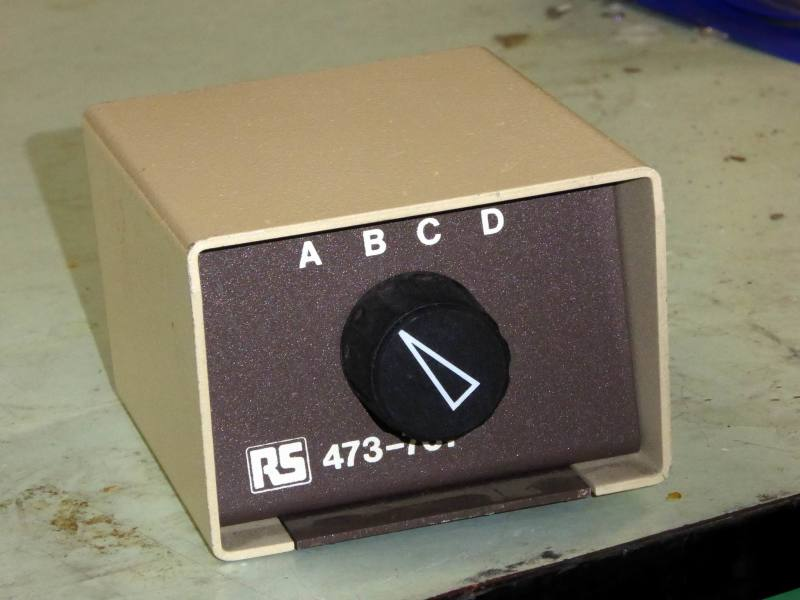 Small cream & brown rotary video source select switch