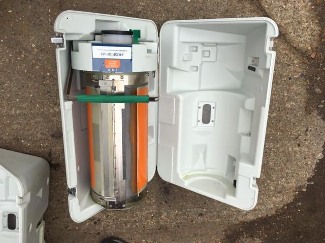 Space suitcase with hi-tech looking cylindrical content