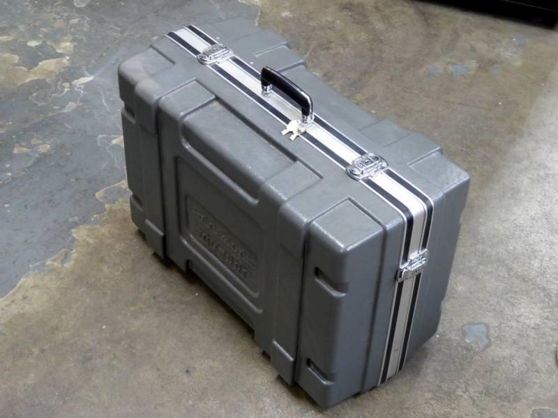 Ruggedised, ribbed grey plastic flight case
