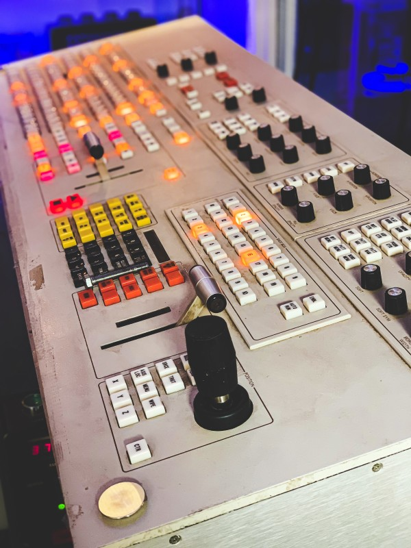 Large practical vision mixer console with colourful buttons