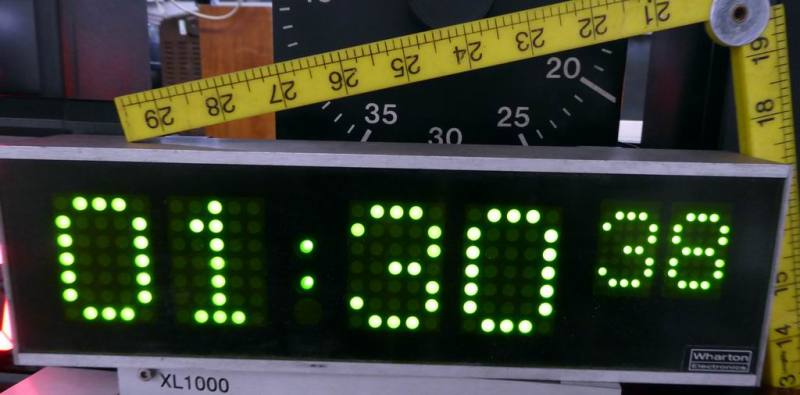 Stylish green dot matrix digital clock.