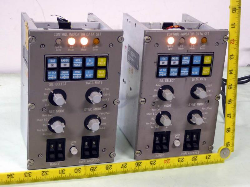 Practical grey aircraft control panels with coloured buttons, switches & lamps