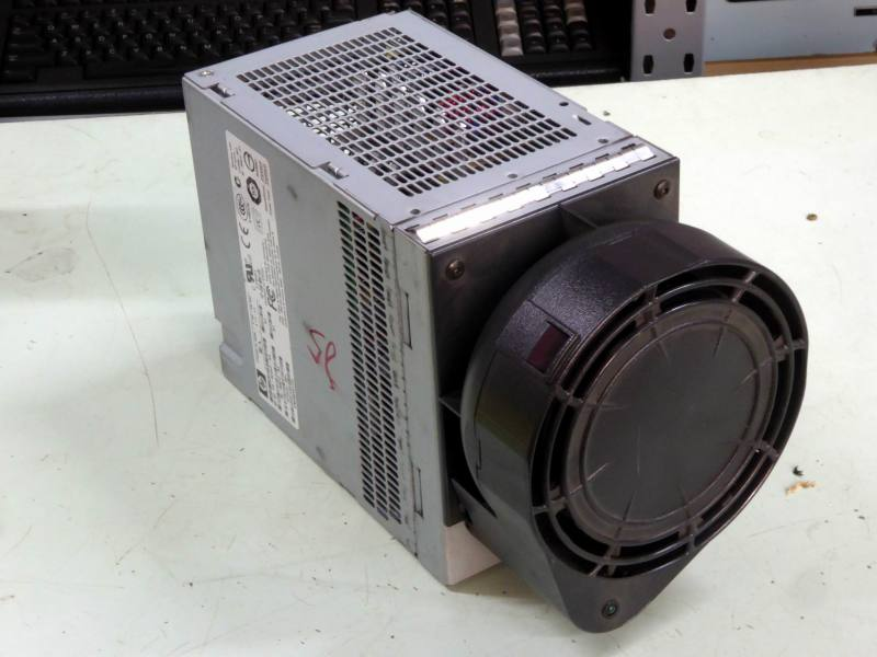 Technical looking computer power supply with large blower assembly