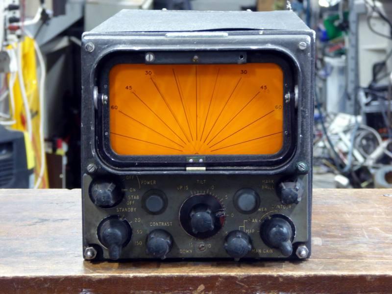 Aircraft radar display panel with knobs & orange rising sun display