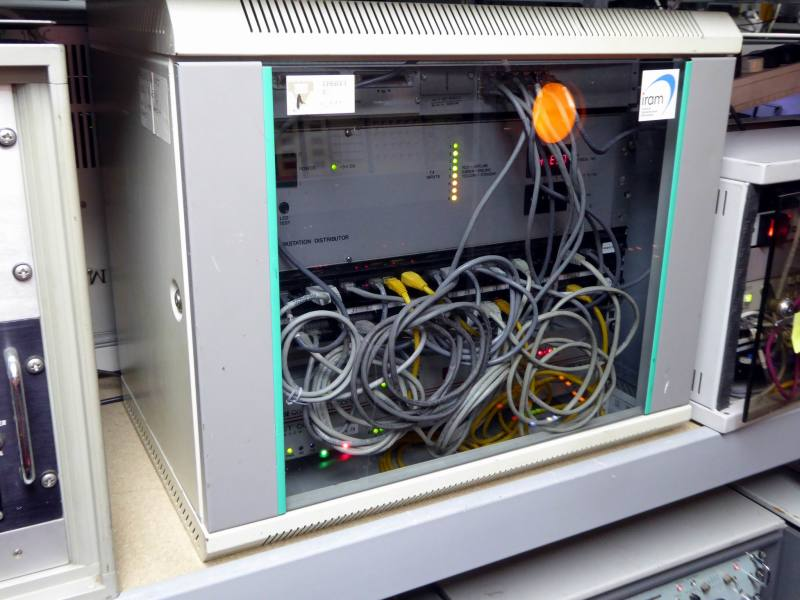 Practical glass-fronted network communications cabinet with twinkling LEDs