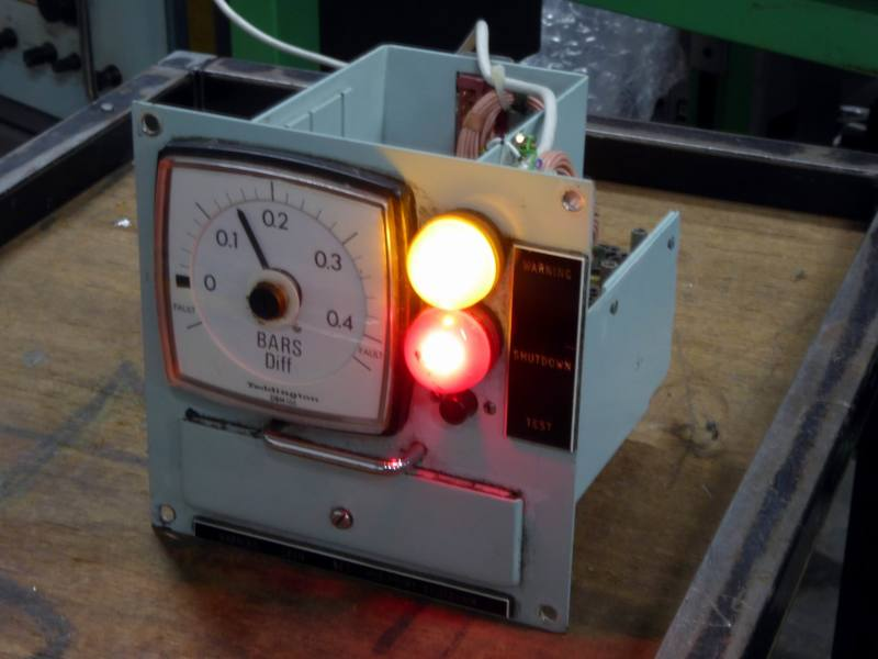 Practical navy control panels with large domed coloured lamps & analogue meter