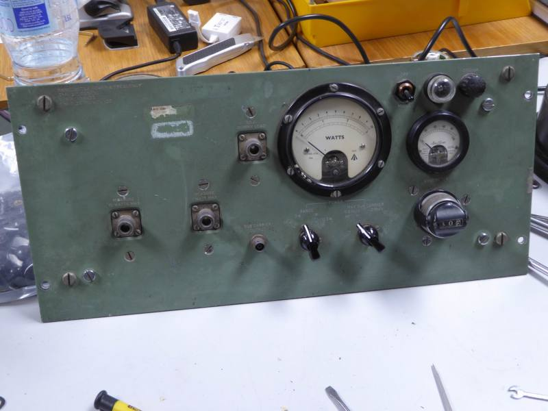 Period control panel in muddy green with knobs, switches & analogue meter