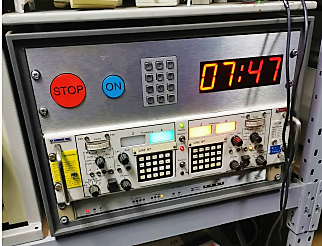 Desktop cabinet with microwave countdown timer and flashing lights
