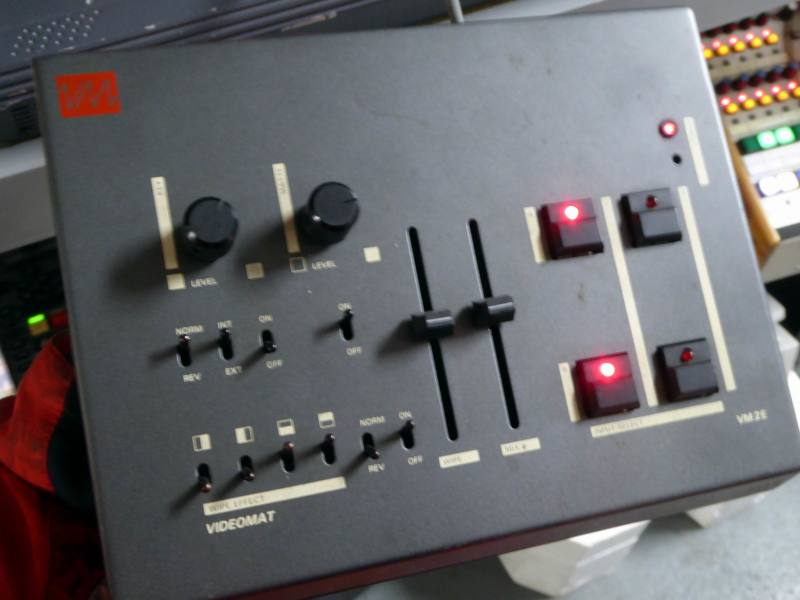 Small desktop video mixer/effects generator with linear faders. knobs, LEDs