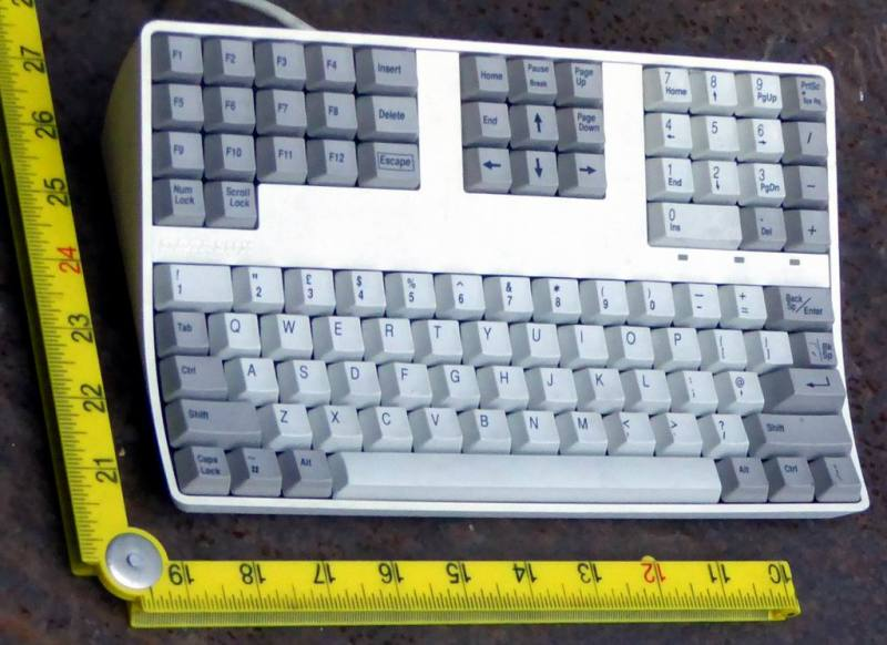 Small footprint steeply raked practical keyboard