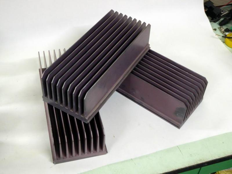 Hi-tech, large, extruded, anodised aluminium heat sink shapes with long fins.