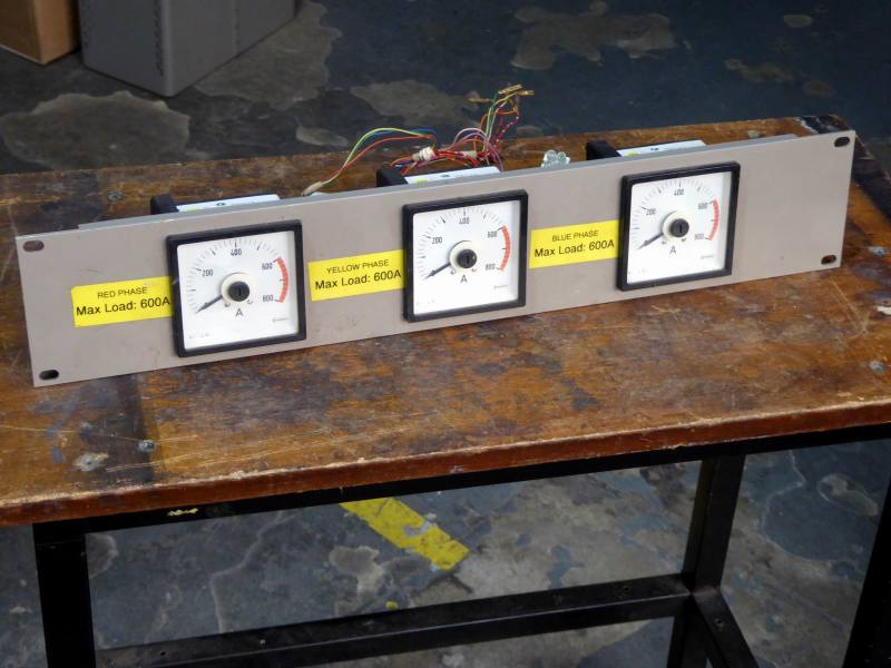 Triple electrical 270° panel meters with movable pointers & part red scales