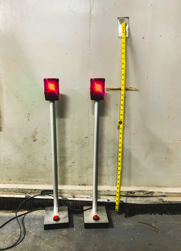 Flashing red beacon lights on poles
