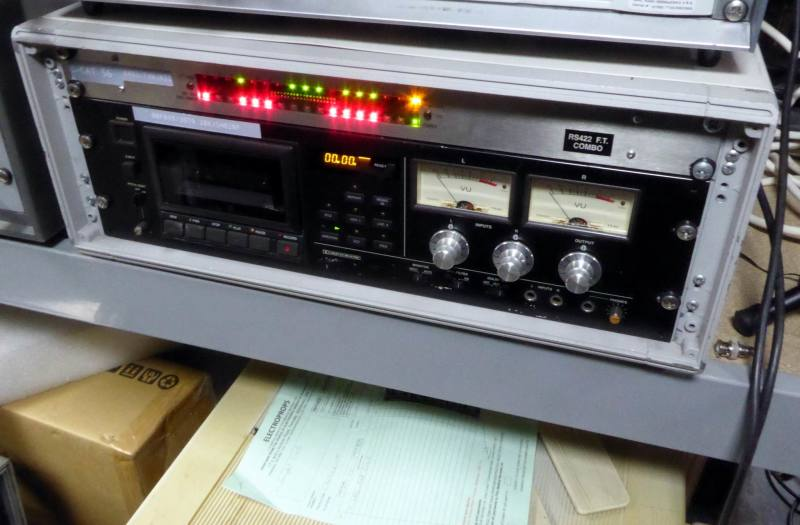 Practical black audio cassette tape deck in low desk top cabinet