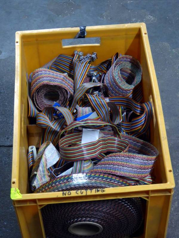 Crate of assorted rainbow coloured ribbon cable